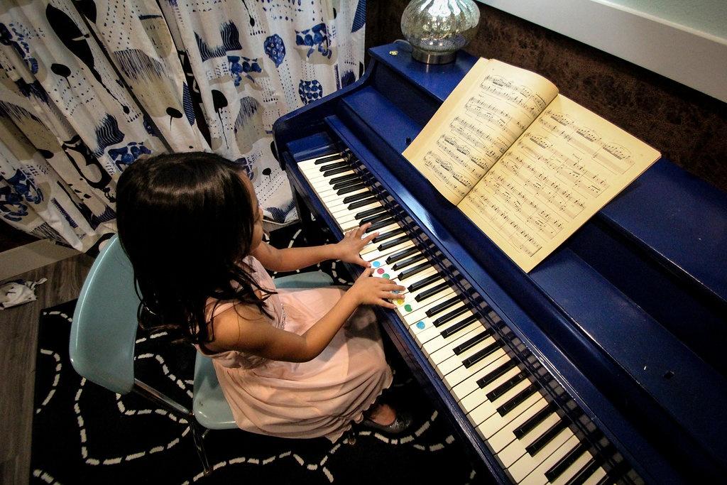 5 yr playing blue piano.jpg
